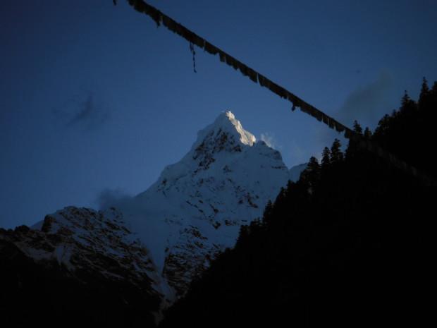 Sacred, Unclimbed Mt. Meili on the Tibet/China border.  photo:  miles clark