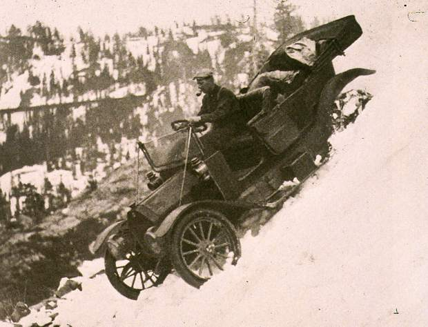 Courtesy Searls Historical Library Arthur Foote behind the wheel of his car descending to Donner Lake. Note the door is open for a quick jump if necessary. Also note the railroad snow sheds in the background.