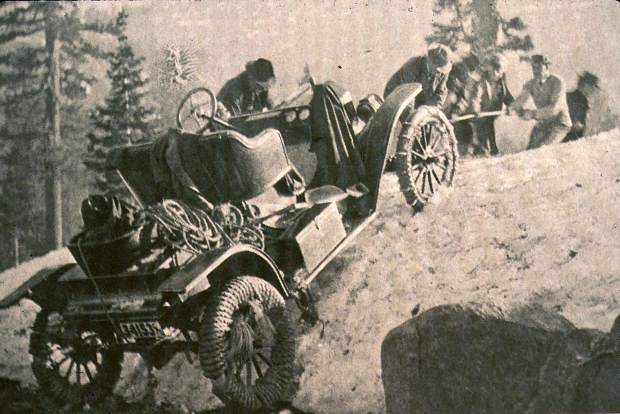 Courtesy Searls Historical Library Men from Grass Valley push, pull, and drag a Model T automobile over Sierra drifts in June 1911. Rope is wrapped around the tires for traction.