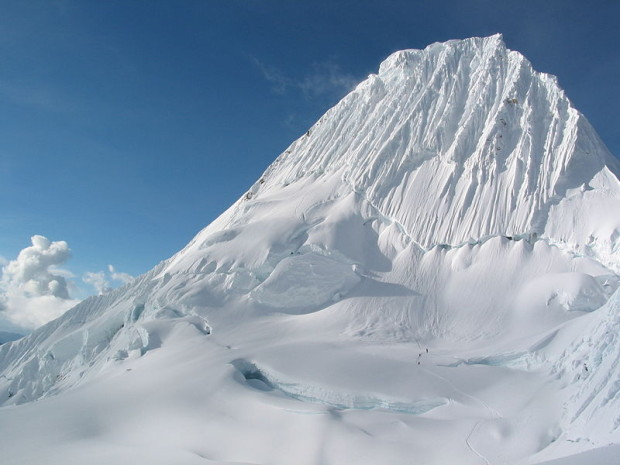 Alpamayo with climbers for scale