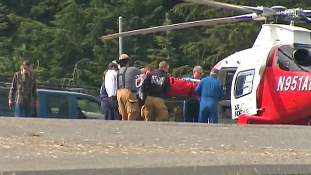 One of the more seriously injured employees being loaded into helicopter.  photo:  kirotv