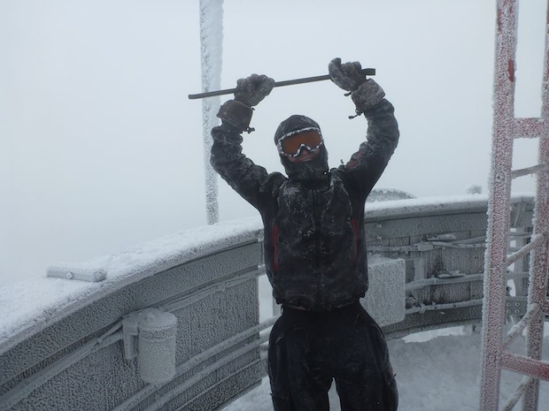 Summit intern Tom Padham dusts off the trusty crowbar for some rime ice removal earlier today in his (rime-encrusted) EMS Fader Jacket! - Mt. Washington Observatory