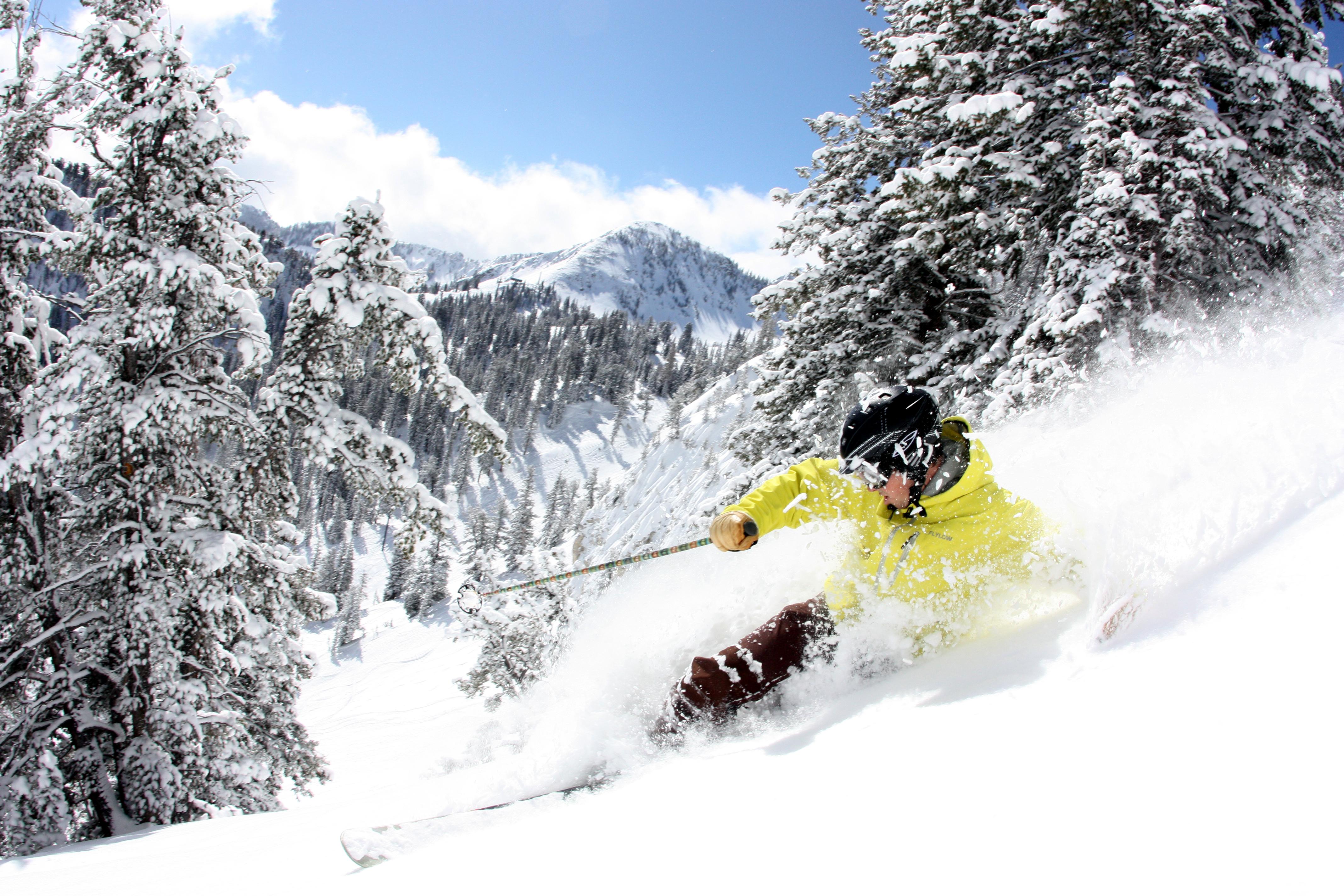A person skiing down a slope at Solitude ski resort