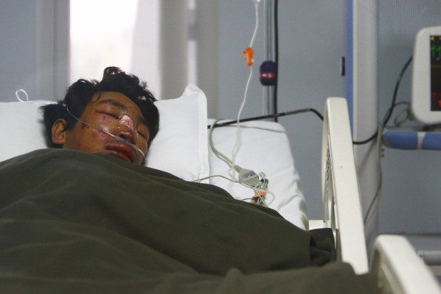 Dawa Tashi Sherpa lies on the bed of the Intensive Care Unit at Grandi International Hospital after he was rescued and airlifted from the avalanche site at Mount Everest in Kathmandu April 18, 2014.