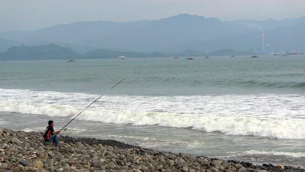 pembulatan  Ratu power plant, coal barges, and Cimaja fisherman.