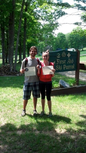 Aaron and his fiancé showing off their re-certification for the National Ski Patrol
