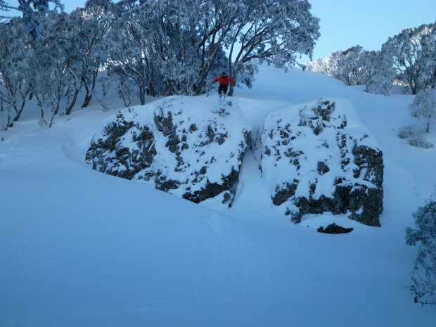 Joe cliff hucking in front of the lodge.