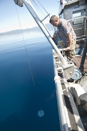 Raph Townsends drops a  Secchi disk and marks the depth when the disk disappears to check water clarity at Lake Tahoe, California on Thursday June 6, 2013.  The UC Davis Tahoe Environmental Research Center does testing, monitoring, and conservation on the lake.