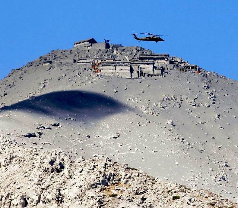 Mountain lodge buried in ash after eruption on Mt. Ontake. photo: kimmasa mayama/epa