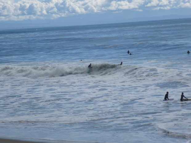 People still surfing in sub par conditions. Two bodyboarders hit the shore break showing the diversity of the surf spot.
