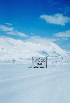 Speed Limit sign buried on Thompson Pass, AK.