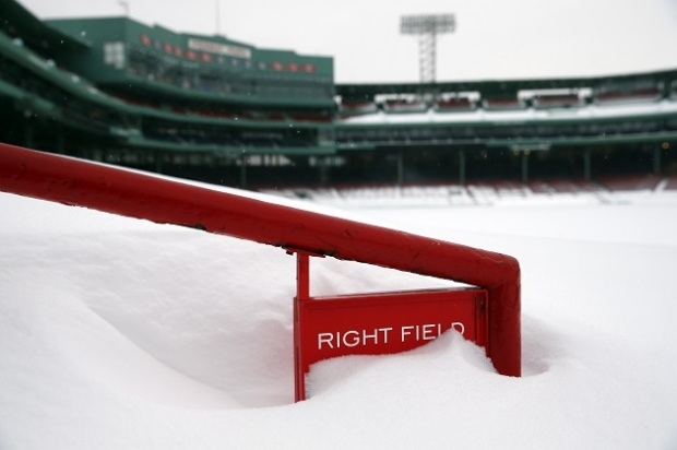BOSTON - FEBRUARY 9: The Right Field seats are covered in snow at Fenway Park in Boston, Mass. on Feb. 9, 2015, as yet another winter storm brings mounting accumulation. (Photo by Jessica Rinaldi/The Boston Globe via Getty Images)
