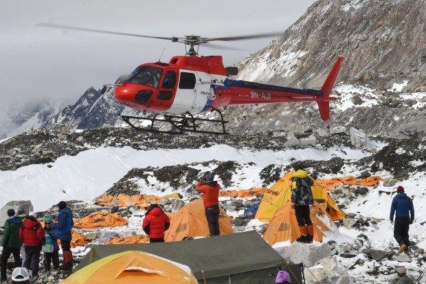 Injured climbers and Sherpa being airlifted from basecamp yesterday.  photo:  afp