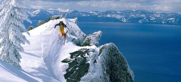Dropping into the Lake Tahoe backcountry with Lake Tahoe in the background.