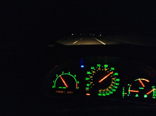 Focus on the road at night.