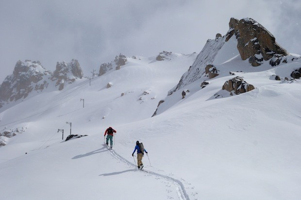 Two SASS guides skinning up La Laguna at Catedral ski resort in Bariloche, Argentina in August 2014.  photo:  snowbrains