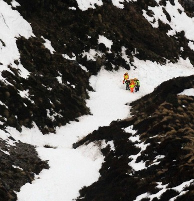 Rescuers probing for a pair of missing French Canadian tourists found the second body in this old avalanche near Keplar Track.
