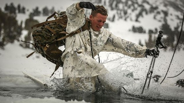 Sgt. Sloan Seiler, Winter Mountain Leaders Course 1-15, student, Marine Corps Mountain Warfare Training Center, and 1st Lt. Mancelino Figueroa, WMLC 1-15, class commander, 1st Battalion, 3rd Marine Regiment, lead a line of Marines pulling a block of ice back into Levitt Lake at the MCMWTC, Bridgeport Calif., Jan. 30, 2015. The blocks of ice that were cut out of the lake were returned after the Marines concluded training. (Official Marine Corps photo by Cpl. Charles Santamaria/Released)