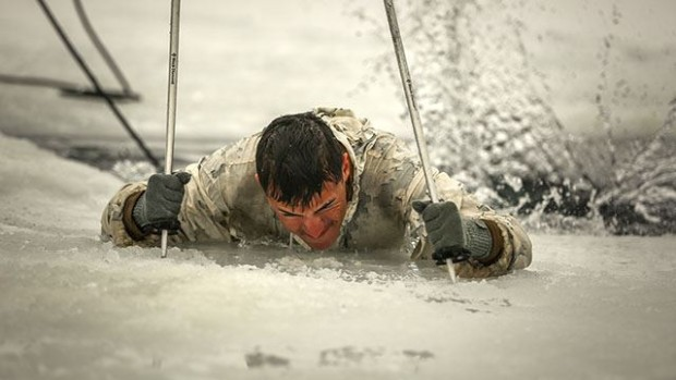 Cpl. Jacob Mattison, Winter Mountain Leaders Course 1-15, student, 1st Battalion, 3rd Marine Regiment, native of Mankato, Minn., digs his ski poles into the ice to gain enough leverage to climb his way out of freezing water during an Ice-Breaker Drill as part of WMLC 1-15 at Levitt Lake, Marine Corps Mountain Warfare Training Center, Bridgeport, Calif., Jan. 30, 2015. Once the students got out of the water, they sprinted to the warming tents, where they stripped off their wet clothing and put on dry clothes to restore their body's normal temperature. (Official Marine Corps photo by Cpl. Charles Santamaria/Released)