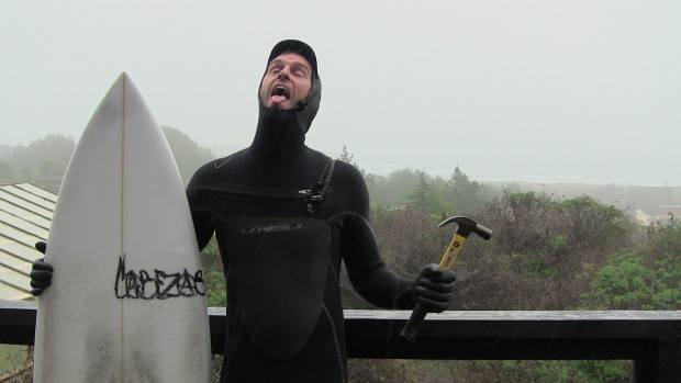 The author going surfing in the rain at Lobos.  Cold, wet, terrible winter waves on a stormy day.