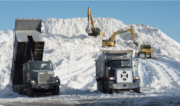 """In February, workers used heavy machinery at the """"snow farm"""" in the Seaport district. Credit John Cetrino/European Pressphoto Agency"""