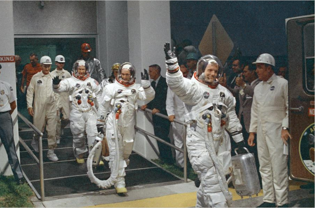 Neil Armstrong waving in front, and the crew or Apollo 11, head for the van that will take the crew to the rocket for launch to the moon at Kennedy Space Center in Merritt Island, Florida, on July 16, 1969. #