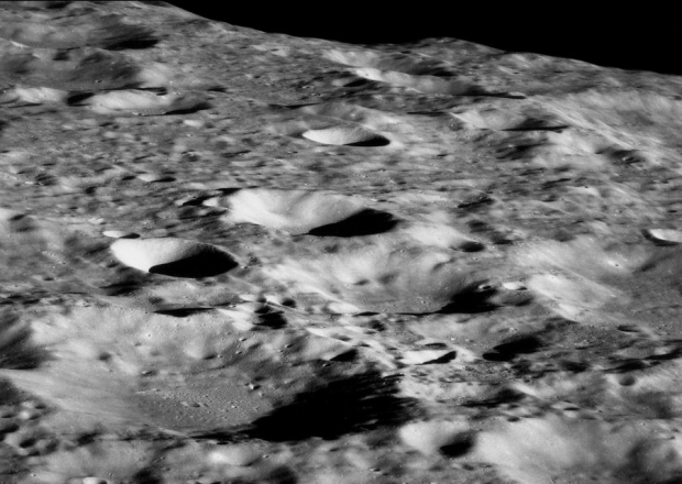 eaching lunar orbit, a view of the surface west of Daedalus Crater. #