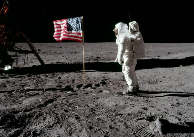 Buzz Aldrin salutes the deployed United States flag during the Apollo 11 Extravehicular Activity (EVA) on the lunar surface. Astronaut Neil Armstrong took this picture with a 70mm Hasselblad lunar surface camera