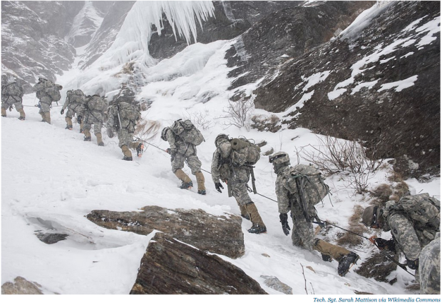 Soldiers attending the US Army Mountain Warfare School in Jericho, Vermont, climb Smugglers' Notch as part of their final phase of the Basic Military Mountaineering Course, February 19, 2015.