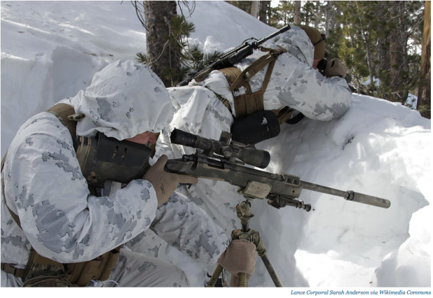 A shooter and his spotter prepare a shot during the Mountain Scout Sniper Course at Marine Corps Mountain Warfare Training Center, Bridgeport, California.