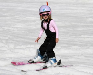 A young girl skiing.