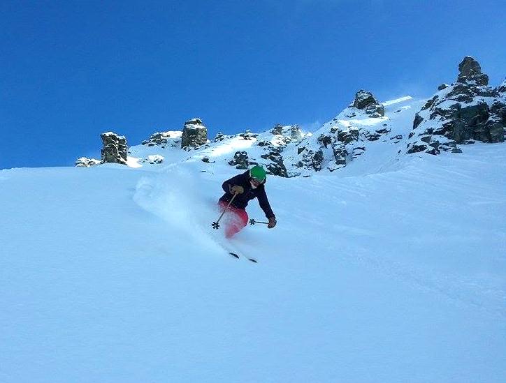 Athlete Marian Krogh skiing fresh snow in the Saddle Basin