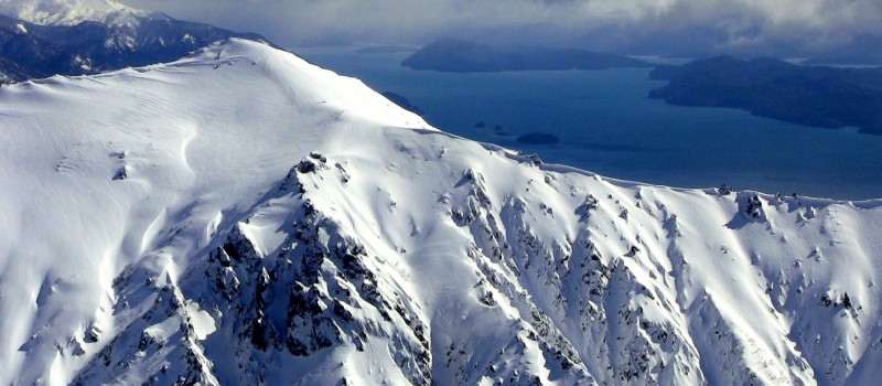 Bella Vista peak and gorgeous Lake Nahuel Huapi in Bariloche, Argentina as seen from Catedral ski resort. photo: miles clark/snowbrains