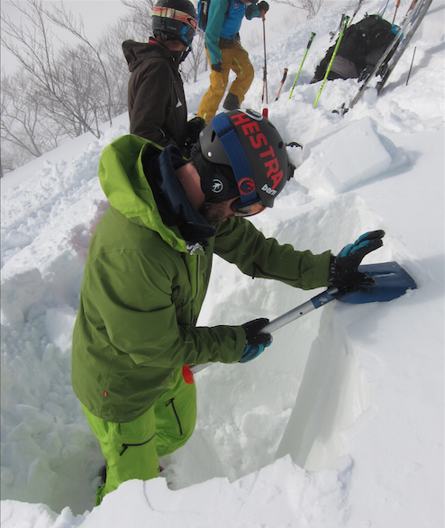 backcountry etiquette, Guide Miles Clark digging a snow pit in Japan on an unstable day.