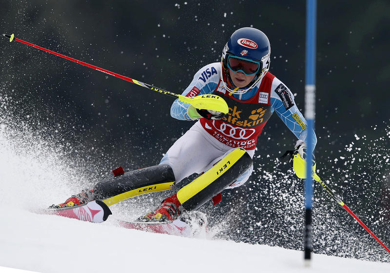 Mikaela Shiffrin, of the United States, speeds down the course during the second run of an alpine ski, women's World Cup slalom race, at the World Cup finals in Meribel, France, Saturday, March 21, 2015. (AP Photo/Shinichiro Tanaka)