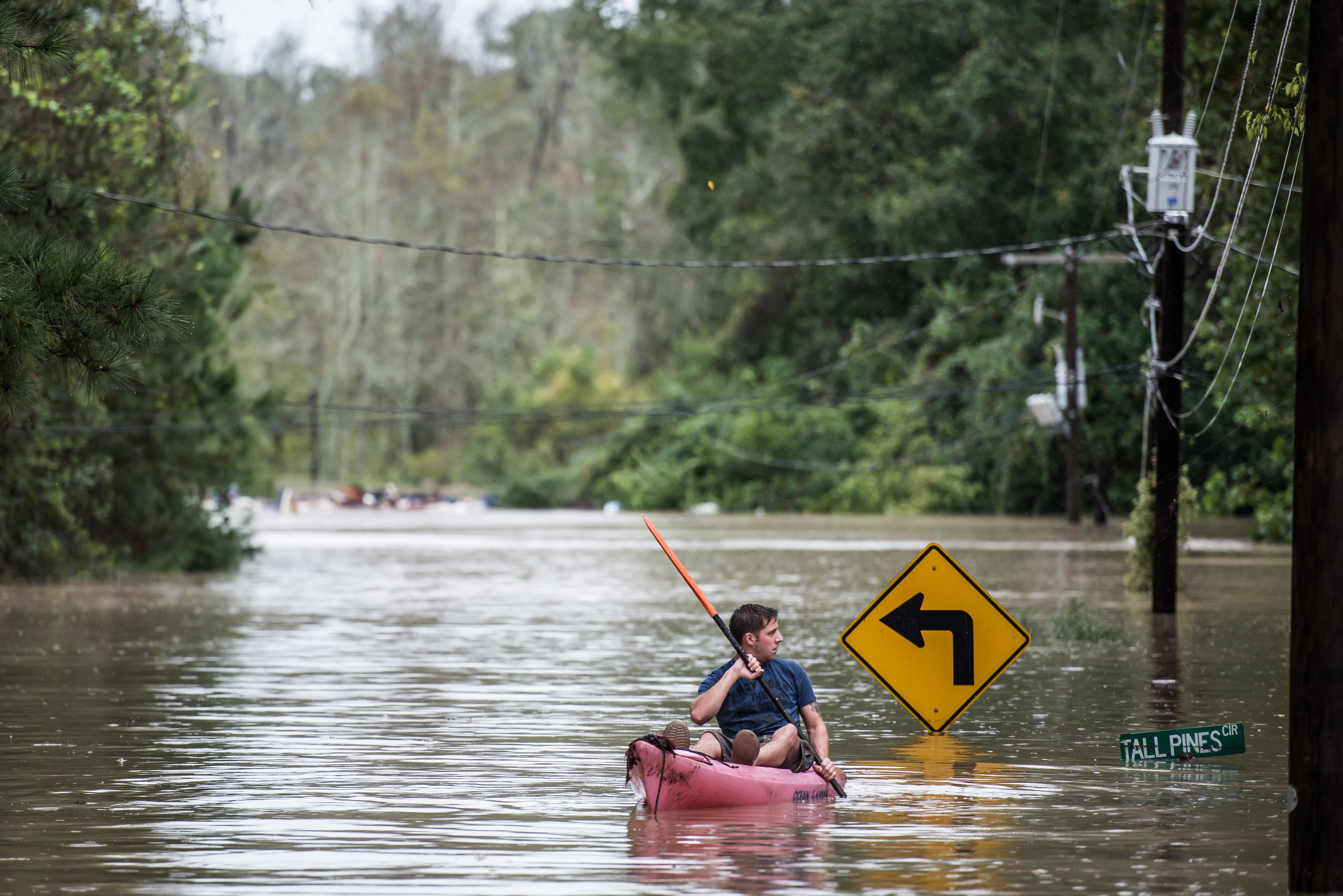 A man kayaking on Tall Pines Circle in Columbia, South Carolina on October 4, 2015. photo: paul fayfield/getty images