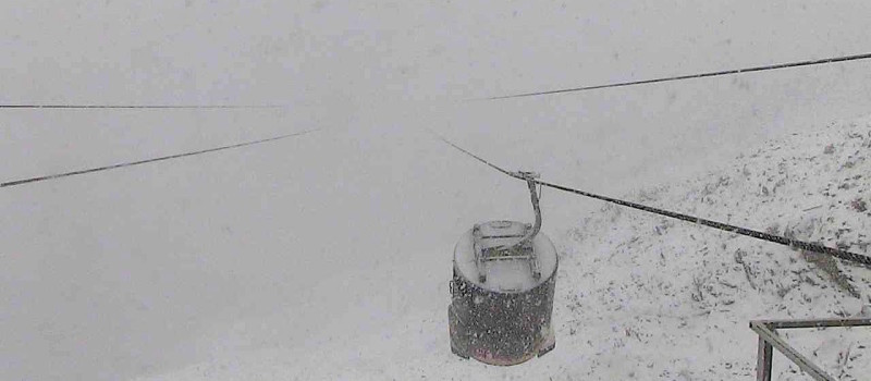 Lone Peak Tram at Big Sky, MT in a big snowstorm on Sept. 15th, 2015.