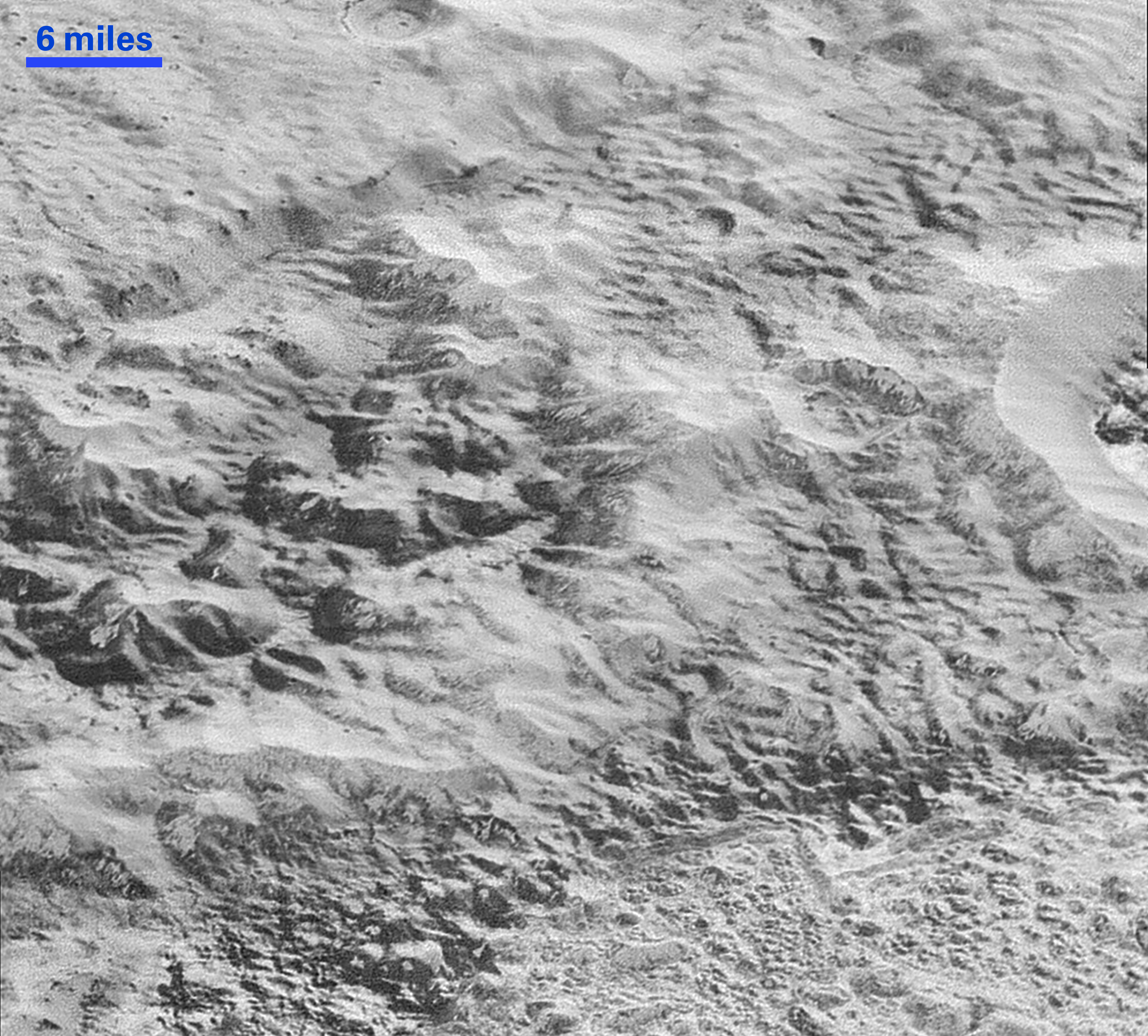 Pluto's 'Badlands': This highest-resolution image from NASA's New Horizons spacecraft shows how erosion and faulting have sculpted this portion of Pluto's icy crust into rugged badlands topography. Credits: NASA/JHUAPL/SwRI