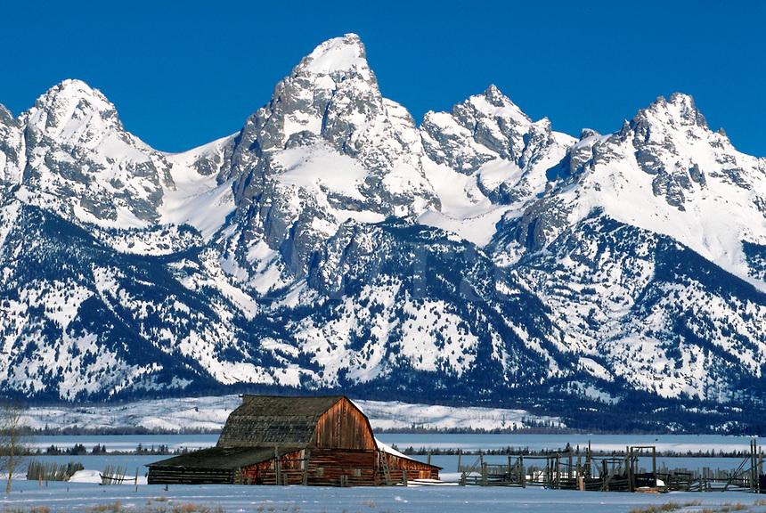 Winter scene of an old barn in foreground of Teton Mountain Range. Grand Teton National Park, Jackson Hole, Wyoming.