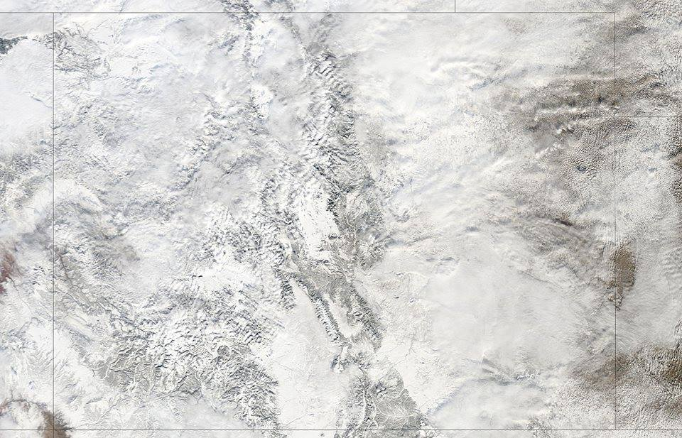 CO looking completely snow covered from space on January 9th. photo: nasa