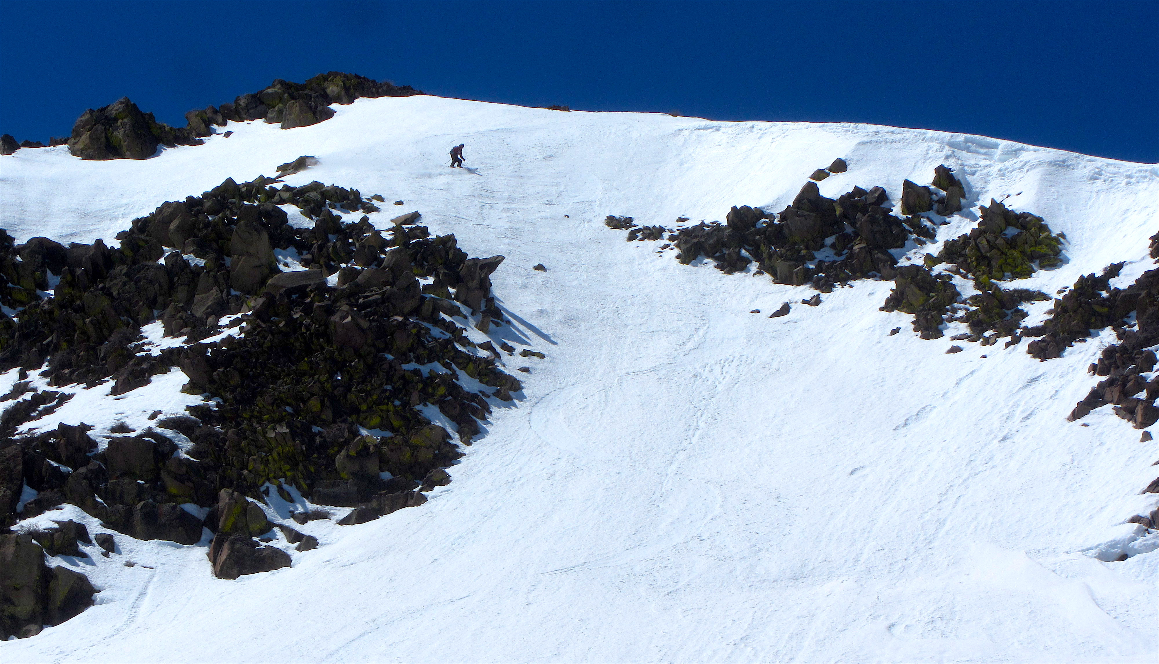 Rick dropping into the Comma Couloir today. photo: miles clark/snowbrains