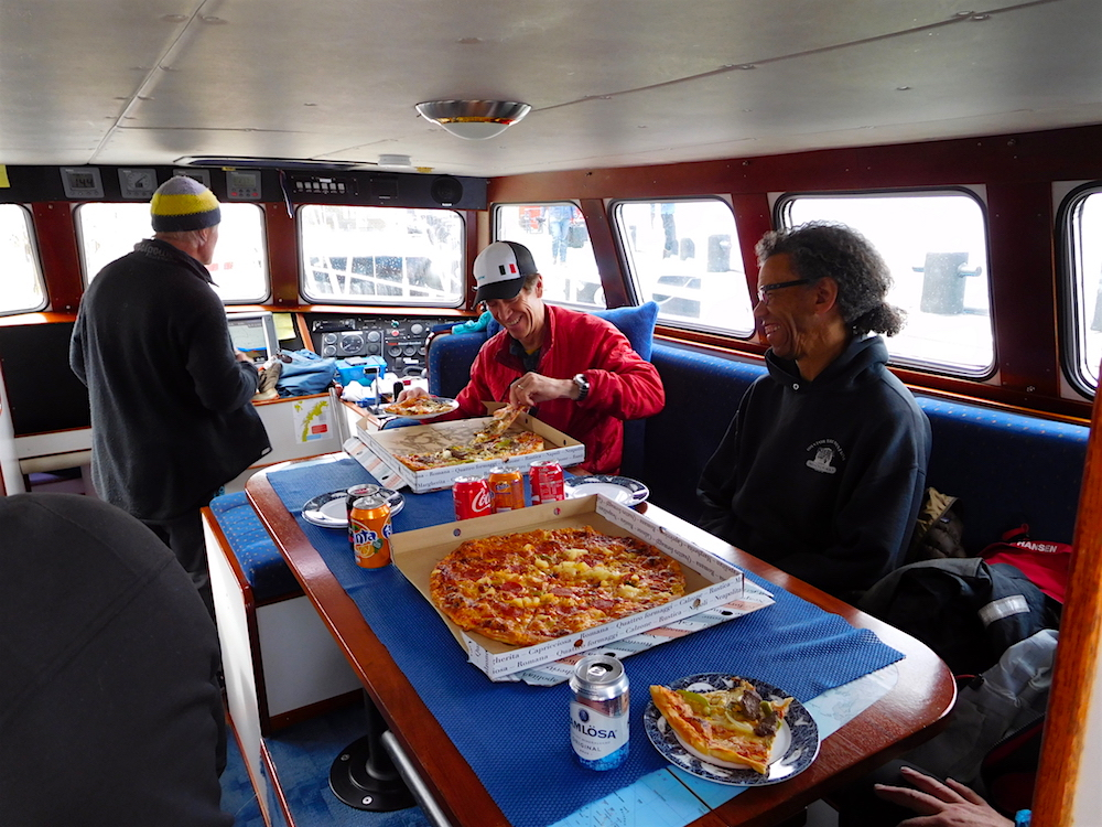 Pizza and smiles before our initial sail. photo: snowbrains