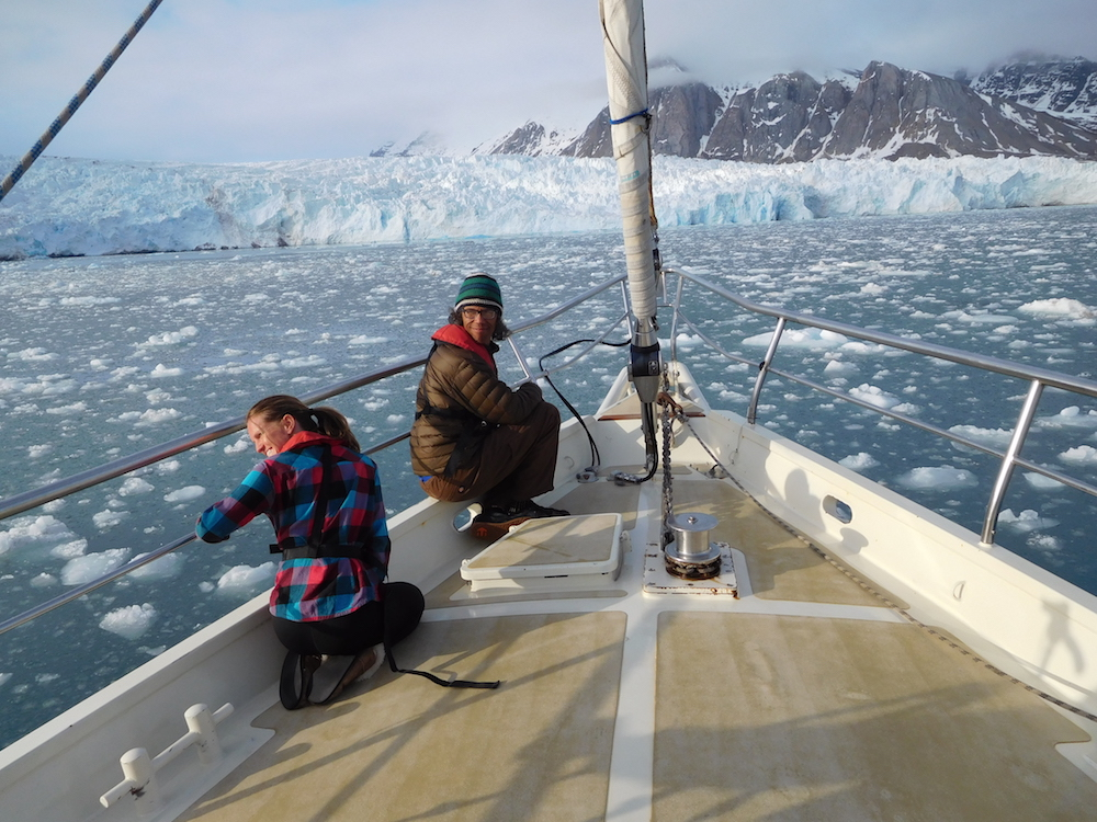 Liz & Gary taking in the glacier calving. photo: snowbrains