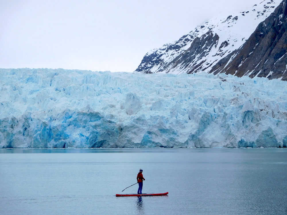 Liz looking comfy on the SUP. photo: snowbrains