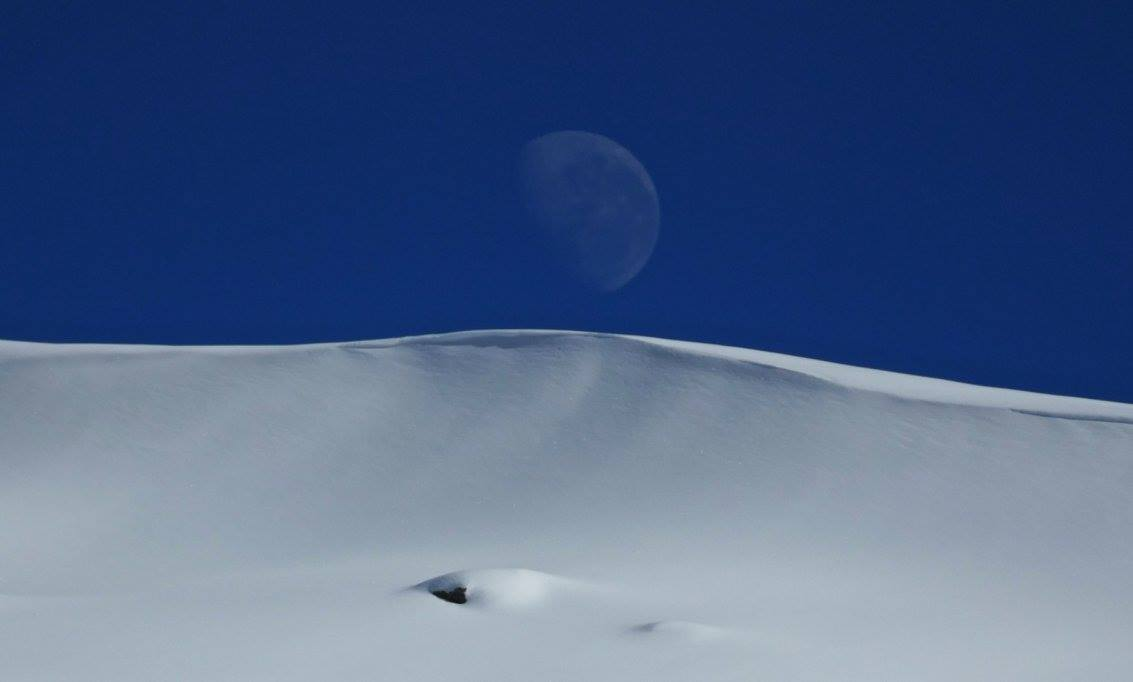 Mt. McKay and the waning moon on August 21st, 2016.  photo:  skiing with steve lee