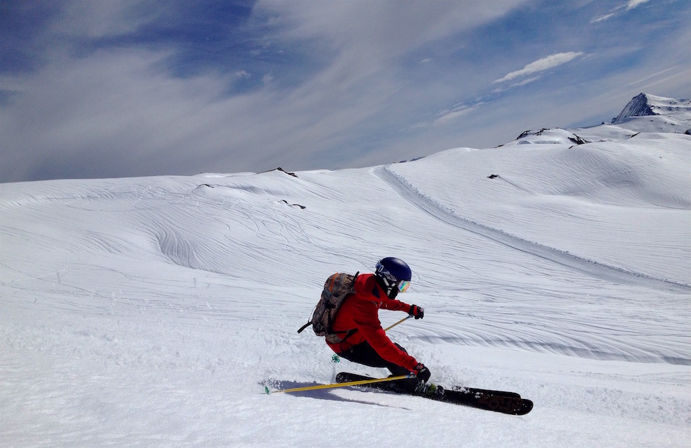 Client Robert tearing it up with the fun runnels in the background. photo: snowbrains