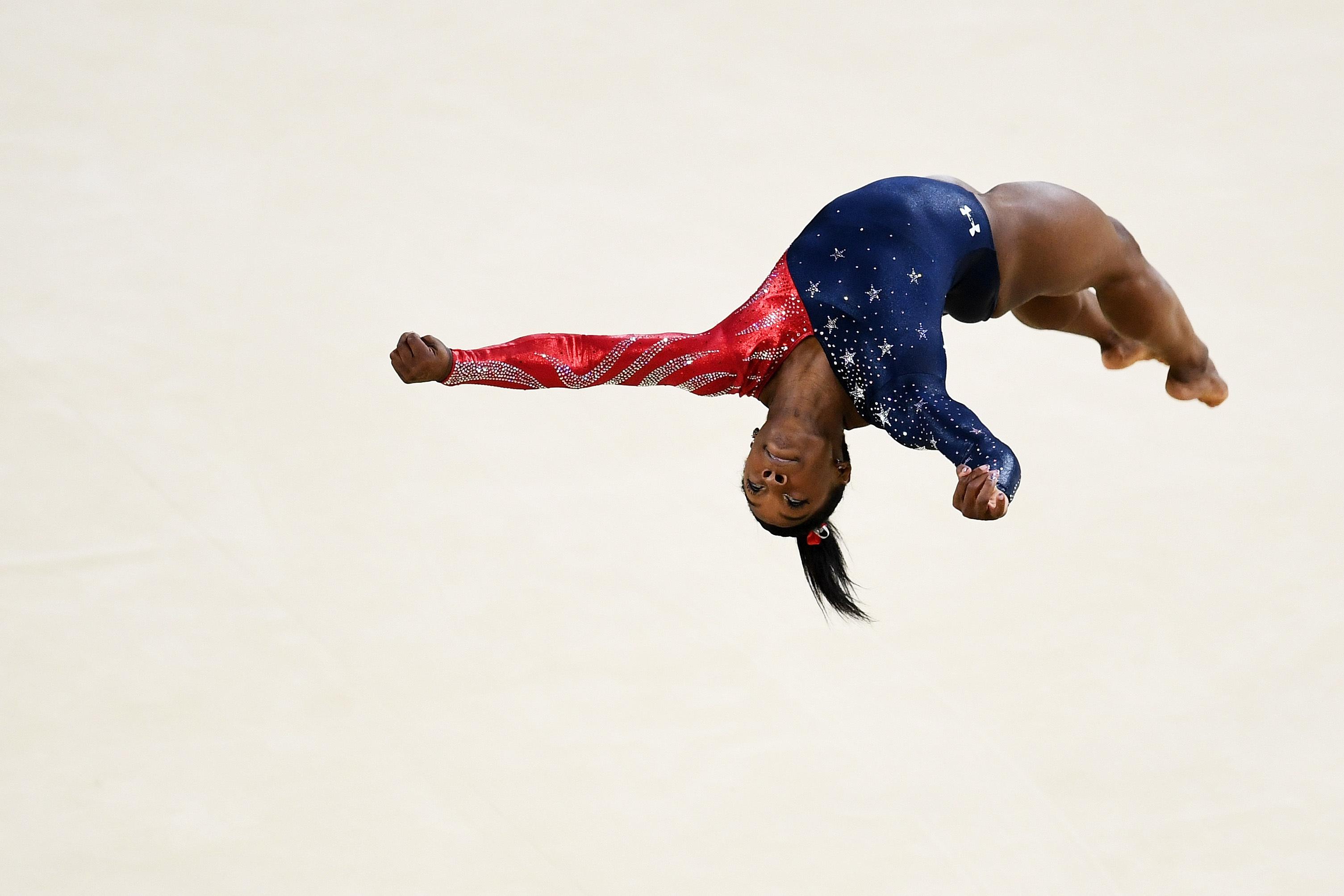 VIDEO: Double Backflip Layout Half-Twist on the Floor ... Nastia Liukin Gymnastics Wallpaper
