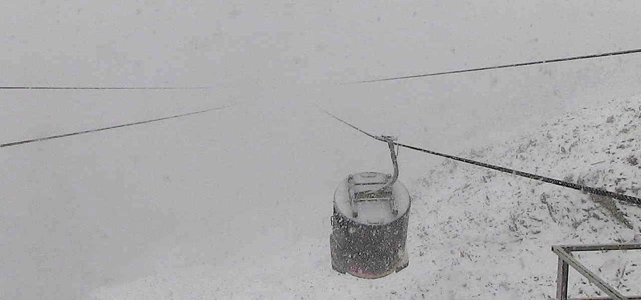 Lone Peak Tram at Big Sky, MT in a big snowstorm on Sept. 15th, 2015. photo: big sky