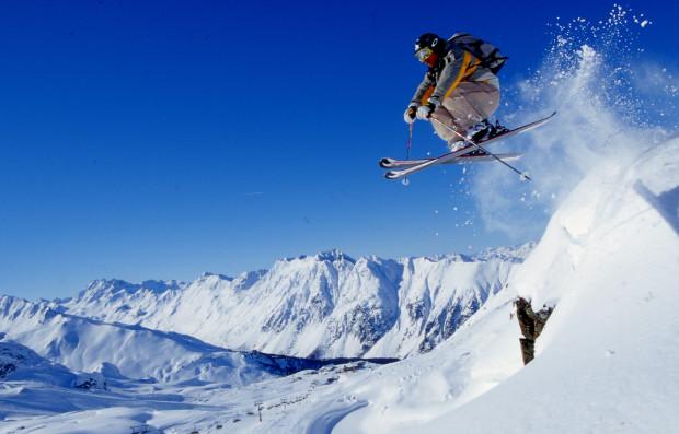 Skier hitting a jump