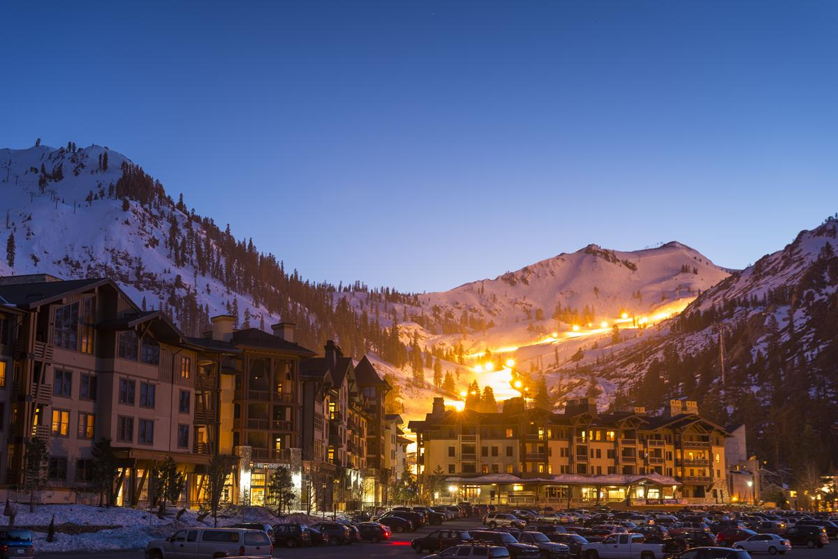 The Village at Squaw Valley, CA, during a night shot with the mountain run in the background